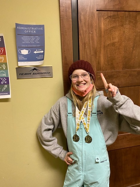 Charlotte Nagle ITS Summit Cup Breckenridge Medals at the door.jpg