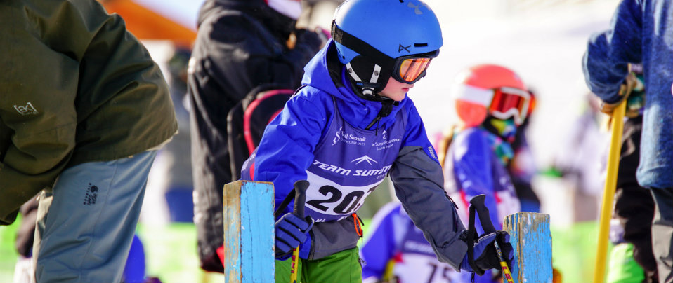 young ski racer at gate